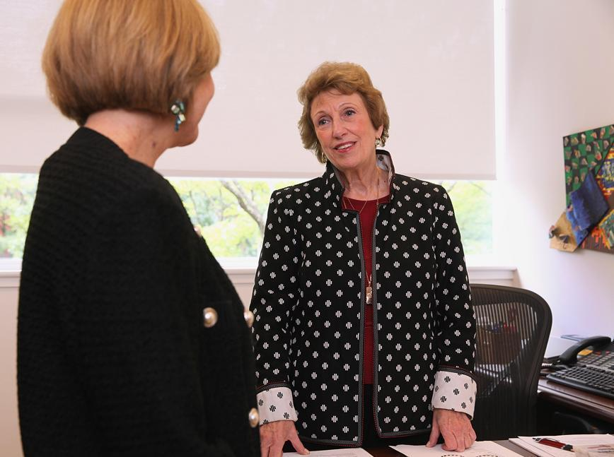 Executive adviser Toni Wolfman (right) spoke with senior director Susan Adams at Bentley University's Center for Women and Business in Waltham.